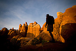 A young man admires the view while hiking in the Fiery Furnace section of Arches National Park in Moab, Utah.