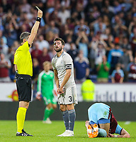 Referee Massimiliano Irrati shows Aberdeen's Graeme Shinnie a yellow card<br /> <br /> Photographer Alex Dodd/CameraSport<br /> <br /> UEFA Europa League - Europa League Qualifying Round 2 2nd Leg - Burnley v Aberdeen - Thursday 2nd August 2018 - Turf Moor - Burnley<br />  <br /> World Copyright © 2018 CameraSport. All rights reserved. 43 Linden Ave. Countesthorpe. Leicester. England. LE8 5PG - Tel: +44 (0) 116 277 4147 - admin@camerasport.com - www.camerasport.com