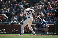 SAN FRANCISCO, CA - APRIL 8:  Kelby Tomlinson #37 of the San Francisco Giants bats against the Los Angeles Dodgers during the game at AT&T Park on Sunday, April 8, 2018 in San Francisco, California. (Photo by Brad Mangin)