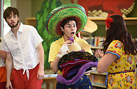 NWA Democrat-Gazette/DAVID GOTTSCHALK Jeremy Lopez (center), with the Studio Artists of Opera in the Ozarks, performs as Pedrito Thursday, July 11, 2019, in the children's opera Monkey See, Monkey Do at the Springdale Library. Children in the audience received an opera related activity book. The artists will perform at the Bentonville Public Library on Saturday, July 13th at 2:00 p.m..
