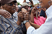 United States President Barack Obama greets a man in the crowd after addressing the Labor Day celebration in Detroit, Michigan, September 5, 2011. .Mandatory Credit: Pete Souza - White House via CNP