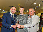Conor Keenan recieves the St Mary's GAA Club senior player of the year award from Club Manager Hugh Dourigan and Chairperson Michael Rooney at their awards night in their clubrooms. Photo:Colin Bell/pressphotos.ie