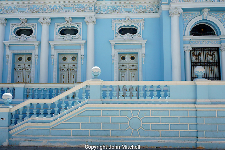 Ornate blue and white facade of a restored Spanish colonial mansion in Merida, Yucatan, Mexico