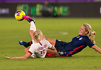 5th March 2020, Orlando, Florida, USA;  the United States midfielder Lindsey Horan (9) is slide tackled by England defender Steph Houghton  during the Women's SheBelieves Cup soccer match between the USA and England on March 5, 2020 at Exploria Stadium in Orlando, FL.