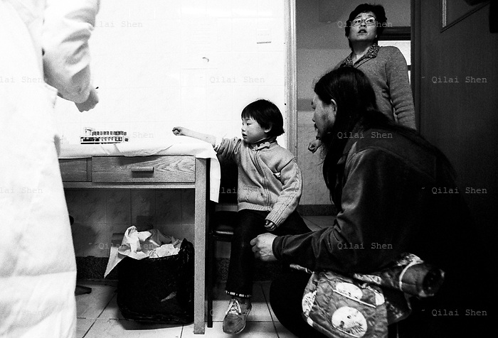 08-Mar-02: Child with HIV: Hebei, China.4 yr old AIDS patient Wang Kaijia (JiaJia) waiting to take a bllod test at Beijing's  Di Tan Hospital, China's center for AIDS and HIV patients. Jiajia's mother (now deceased) got the HIV virus through a hospital blood tranfusion, and possibly in turn passed the virus to Jiajia via breast milk..Photo By: Qilai Shen