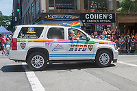 NYPD vehicle decorated for gay pride in the annual Lesbian, Gay, Bisexual, Transgender and Queer (LGBTQ) Pride Parade on Fifth Avenue in New York on Sunday, June 25, 2017. Besides the corporate sponsors, politicians and various social service groups many participants carried political themed signs showing their dissatisfaction with President Trump. (© Richard B. Levine)
