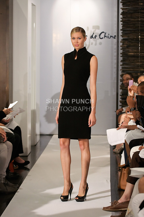 Model walks runway in an outfit from the Blanc de Chine Spring/Summer 2012 collection, during New York Fashion Week Spring 2012, September 10, 2011.