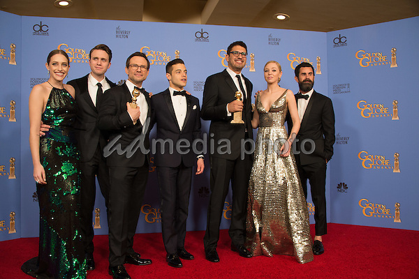 "For BEST TELEVISION SERIES – DRAMA, the Golden Globe is awarded to ""Mr. Robot"" (USA Network). Carly Chaikin, Martin Wallström, Christian Slater, Rami Malek, Sam Esmail, Portia Doubleday and Chad Hamilton pose with the award backstage in the press room at the 73rd Annual Golden Globe Awards at the Beverly Hilton in Beverly Hills, CA on Sunday, January 10, 2016. Photo Credit: HFPA/AdMedia"