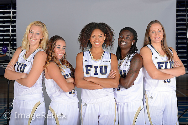 14 October 2015:  FIU's juniors (pictured, left to right, guard/forward Janka Hegedus (13), guard Nikolina Todorovic (23), forward Soraya Page (32), guard Tianah Alvarado (3) and guard/forward Katrina Epnere (10)) pose during picture day at FIU Arena in Miami, Florida.