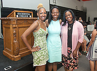 From left, Jazmine Brand '14, Jessica Maxwell '06 and Jessica's mother pose after Jessica gave the Class Day address at Senior Brunch and Class Day, May 16, 2014 in Rush Gym. (Photo by Marc Campos, Occidental College Photographer)