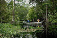 A model released image of a father and daughter sliently gliding into deep foilage in a motor boat at Blue Cypress lake in Florida in April. M