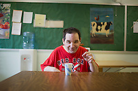 Fernald resident Michael Martin drinks ginger ale during a break from work at Site 7 at the Fernald Developmental Center in Waltham, Massachusetts, USA.  Michael, 52, cannot speak. Some of the residents perform menial tasks for pay.  Michael shreds documents.