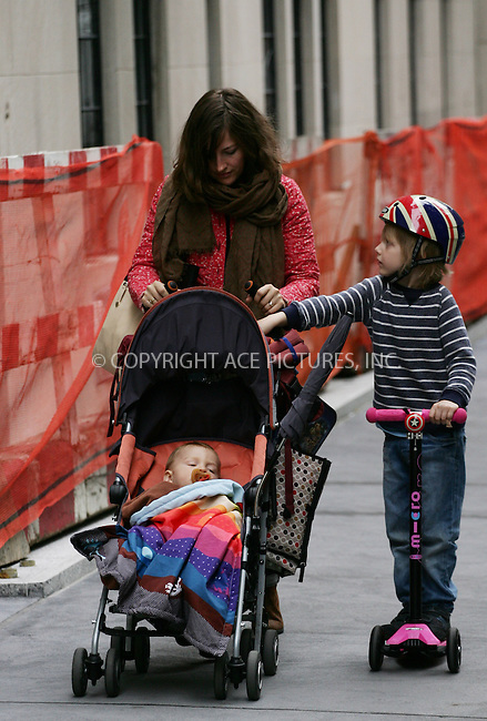 WWW.ACEPIXS.COM<br /> <br /> October 8 2013, New York City<br /> <br /> Actress Kelly McDonald walks with her sons Freddie (R) and Theodore in the East Village on October 8 2013 in New York City<br /> <br /> By Line: Shooter/ACE Pictures<br /> <br /> <br /> ACE Pictures, Inc.<br /> tel: 646 769 0430<br /> Email: info@acepixs.com<br /> www.acepixs.com