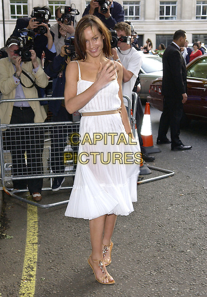 TARA PALMER TOMKINSON.Attends the Glamour Women of the Year Awards 2005,.Berkeley Square, London, .June 7th 2005..full length white pleated summery dress brown ribbon belt.Ref: FIN.www.capitalpictures.com.sales@capitalpictures.com.©Steve Finn/Capital Pictures.