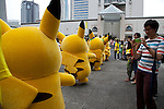 "A visitor takes a picture of Pikachu during the parade at the ""1000 Pikachu Outbreak! at Yokohama Minatomirai"" on August 09, 2014. 1000 Pikachu performed at different areas of Minatomirai in Yokohama during the summer vacation event from August 9 to 17.  (Photo by Rodrigo Reyes Marin/AFLO)"