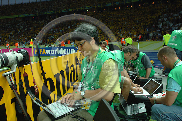 """BERLIN - GERMANY 15. JUNE 2006 - Olympiastadion -- FIFA World Cup 2006 - Sweden - Paraguay - 1-0. Photographers sending pictures during the break.  -- PHOTO: GORM K. GAARE / EUP & IMAGES..This image is delivered according to terms set out in """"Terms - Prices & Terms"""". (Please see www.eup-images.com for more details)"""