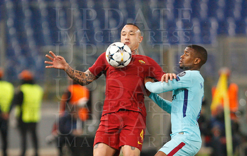 Roma s Radja Nainggolan, left, is challenged by FC Barcelona Nelson Semedo during the Uefa Champions League quarter final second leg football match between AS Roma and FC Barcelona at Rome's Olympic stadium, April 10, 2018.<br /> UPDATE IMAGES PRESS/Riccardo De Luca