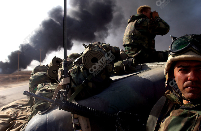 US Marines on the front line in the push to Baghdad as a firefight raged a few hundred metres ahead as Marines pressed forward to the Iraqi capital. April 4, 2003