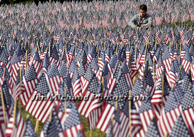 (Boston MA 05/28/16) For some the flags on the Boston Common bring a flood of  emotions, like this man who sits quietly among the flags,  Saturday, May 28, 2016, in Boston Herald Photo by Jim Michaud