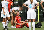 20 September 2009: A trainer checks on Auburn's Lizzie Hamersley (17) after she suffered an apparent head injury. The University of North Carolina Tar Heels played the Auburn University Tigers to a 0-0 tie after overtime at Koskinen Stadium in Durham, North Carolina in an NCAA Division I Women's college soccer game.