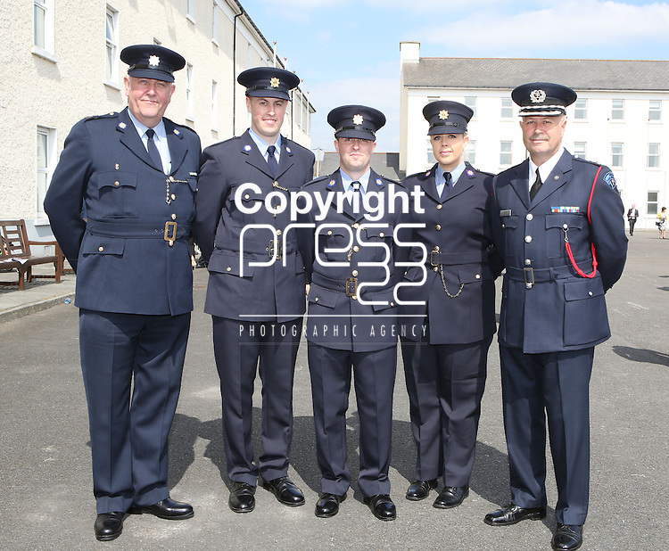 Attending the Garda graduations in Templemore on Thursday were  siblings Jennifer Bell with her graduating brothers Joseph and Brian from Lucan with dad fire officer dad David(right) and uncle Garda Chris Burdock, Pearse St.(left)<br />  Photograph Liam Burke/Press 22