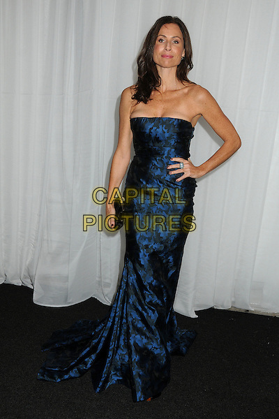 Minnie Driver.2011 MOCA Gala - An Artist's Life Manifesto held at MOCA Grand Avenue,  Los Angeles, California, USA, .12th November 2011..full length strapless navy blue dress hand on hip long maxi  clutch bag .CAP/ADM/BP.©Byron Purvis/AdMedia/Capital Pictures.