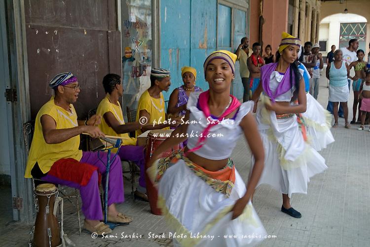 Cuban band Los 4 Vientos and dancers entertaining people in the street, Havana, Cuba.