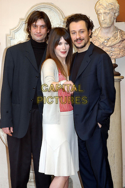 """IVAN FRANEK, VALENTIA CERVI & STEFANO MORDINI.""""Provincia Meccanica"""" photocall.February 7th, 2005.half length, black suit, hand in pocket, white beige skirt, pink striped shirt, pointing, gesture.www.capitalpictures.com.sales@capitalpictures.com.© Capital Pictures."""