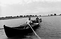ROMANIA, Delta of Danube, Mila 23, April 2000..Fishermen come back home on their boat in the delta of Danube..ROUMANIE, Delta du Danube, Mila 23, Avril 2000..Les hommes rentrent de la peche sur leur barque..© Bruno Cogez