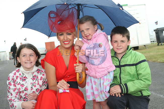 Winner of the Best Dressed Lady Competition, Lynn Keeley with Jude O'Brien, Millie O'Brien and Emmet King at the Bellewstown Races...Photo NEWSFILE/Jenny Matthews.(Photo credit should read Jenny Matthews/NEWSFILE)....This Picture has been sent you under the condtions enclosed by:.Newsfile Ltd..The Studio,.Millmount Abbey,.Drogheda,.Co Meath..Ireland..Tel: +353(0)41-9871240.Fax: +353(0)41-9871260.GSM: +353(0)86-2500958.email: pictures@newsfile.ie.www.newsfile.ie.FTP: 193.120.102.198.