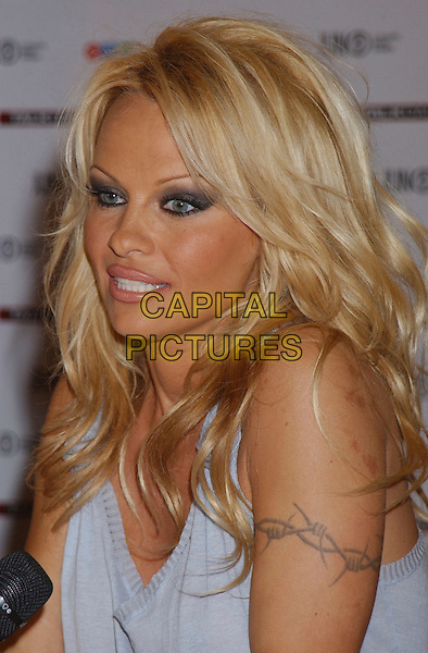 PAMELA ANDERSON.The 35th Annual JUNO Awards Press Conference, held at the Delta Halifax, Halifax, Nova Scotia, Canada,.01 April 2006..portrait headshot tattoo on arm barbed wire.REF: ADM/GS.www.capitalpictures.com.sales@capitalpictures.com.©George Shepherd/AdMedia/Capital Pictures.
