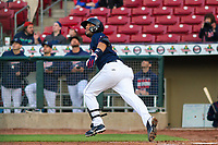 Cedar Rapids Kernels catcher David Banuelos (15) watches a fly ball as he runs to first base during a Midwest League game against the Bowling Green Hot Rods on May 2, 2019 at Perfect Game Field in Cedar Rapids, Iowa. Bowling Green defeated Cedar Rapids 2-0. (Brad Krause/Four Seam Images)