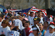 April 10, 2013  (Washington, DC)  A group of people hold a large U.S. flag as thousands of people from across the country gathered at the U.S. Capitol on April 10, 2013, to rally for immigration reform.  (Photo by Don Baxter/Media Images International)