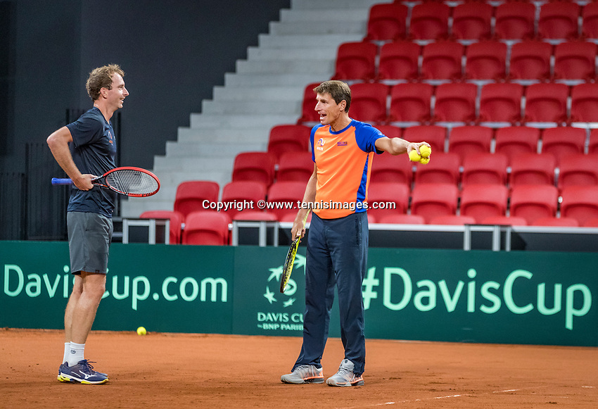 The Hague, The Netherlands, September 11, 2017,  Sportcampus , Davis Cup Netherlands - Chech Republic, training, Captain Paul Haarhuis (R) instructs Matwe Middelkoop (NED) <br /> Photo: Tennisimages/Henk Koster