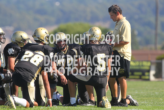Palos Verdes, CA 09/22/11 - Coach Chris Artino and team) in action during the Beverly Hills-Peninsula Varsitty Football gane.