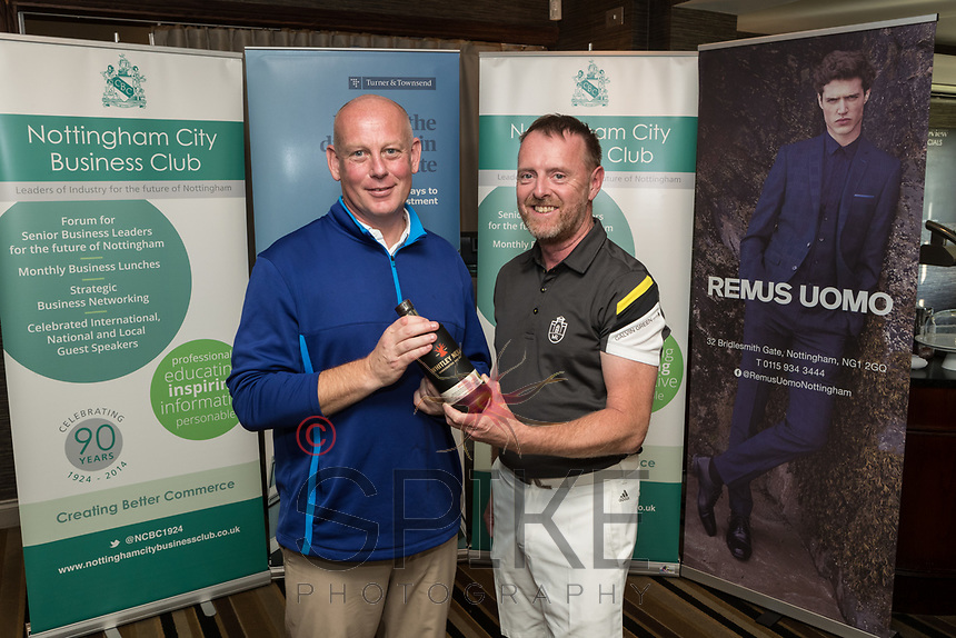 NCBC President Ian Roberts hands over the Nearest the Pin 2nd hole prize of a bottle of Gin donated by Foremost Security to John Miles of John Pye
