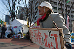 Activist, Sumiko Masunaga (88) at an anti-nuclear power demo and occupy Tokyo protest outside the Ministry of the Economy, Trade and Industry (METI) in Tokyo, Japan. Friday 27th January 2012. The protest has been running from September 2011 and scheduled for forcible eviction by police at 5pm on January 27th, as the camp had been declared a fire risk by Minister Yukio Edano, with around 500 supporters and protesters turning up to resist the eviction however the camp was still in place the night of the 27th.