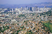 Rio de Janeiro, Brazil. Favela Dona Martha; edges of the shanty town with Sambadrome, downtown area and Niteroi Bridge.