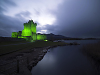 Ross Castle, Killarney, Ireland is illuminated in green for St Patrick's Day..Photograph: Don MacMonagle