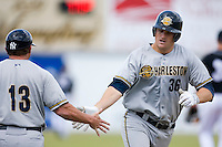 Catcher Brian Baisley (36) of the Charleston RiverDogs is greeted by Charleston RiverDogs manager Torre Tyson (13) as he rounds third base following a home run at L.P. Frans Stadium in Hickory, NC, Sunday, May 4, 2008.