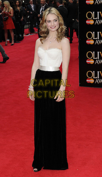 Lily James.The Laurence Olivier Awards 2013, Royal Opera House, Covent Garden, London, England..April 28th, 2013.full length black dress white corset .CAP/CAN.©Can Nguyen/Capital Pictures.