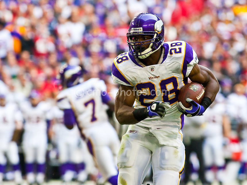 Dec 14, 2008; Glendale, AZ, USA; Minnesota Vikings running back Adrian Peterson (28) runs with the ball in the second quarter of a game against the Arizona Cardinals at University of Phoenix Stadium.  The Vikings won the game 35-14.