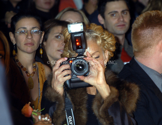 Zang Toi fashion show. Actress-turned photographer for the moment Farrah Fawcett holding her Olympus digital camera. New York, February 13, 2004. ..Please byline: AJ SOKALNER/ACE Pictures.   ..*PAY-PER-USE*      ....IMPORTANT: Please note that our old trade name, NEW YORK PHOTO PRESS (NYPP), is replaced by new name, ACE PICTURES. New York Photo Press and ACE Pictures are owned by All Celebrity Entertainment, Inc.......All Celebrity Entertainment, Inc:  ..contact: Alecsey Boldeskul (646) 267-6913 ..Philip Vaughan (646) 769-0430..e-mail: info@nyphotopress.com