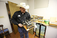 NWA Democrat-Gazette/DAVID GOTTSCHALK  Dennis Huggins, owner and auctioneer of Border Town Auctions, displays an early 19th century Blickensderfer type writer Thursday, May 9, 2019, for the upcoming auction of items from St. Scholastica Monastery in Fort Smith. The nuns of St. Scholastica Monastery moved in January from their very large almost century-old building into a smaller convent. They are selling hundreds of items at auction beginning Thursday.