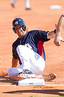 Brett Jackson #6 of the United States World Cup/Pan Am Team steals third base against Team Canada at the USA Baseball National Training Center on September 29, 2011 in Cary, North Carolina.  (Brian Westerholt / Four Seam Images)
