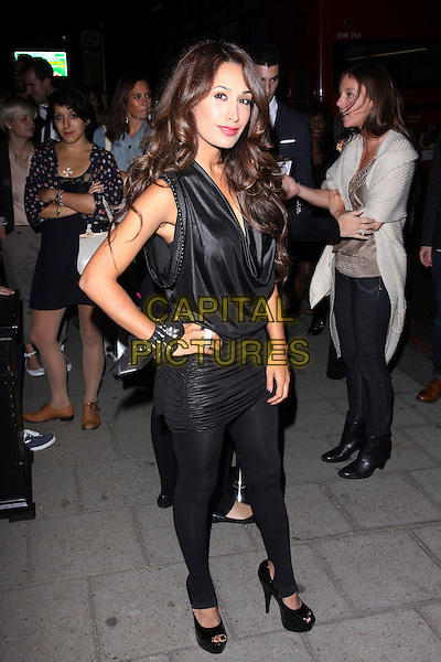 PREEYA KALIDAS.The Sun's new magazine 'Buzz' launch at Il Bottacio, London, England..September 15th, 2010.full length black cowel neck top ruched leggings hand on hip bracelets .CAP/AH.©Adam Houghton/Capital Pictures.