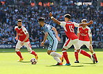 Arsenal's Alex Oxlade-Chamberlain catches Manchester City's Sergio Aguero but no penalty is given during the FA Cup Semi Final match at Wembley Stadium, London. Picture date: April 23rd, 2017. Pic credit should read: David Klein/Sportimage