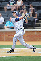 Daniel Pinero (22) of the Virginia Cavaliers follows through on his swing against the Wake Forest Demon Deacons at Wake Forest Baseball Park on May 17, 2014 in Winston-Salem, North Carolina.  The Demon Deacons defeated the Cavaliers 4-3.  (Brian Westerholt/Four Seam Images)
