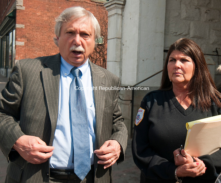 LITCHFIELD, CT--042115JS04- Attorney Anthony DePentima, left, and Bethlehem Animal Control Officer Judy Umstead, right, talk outside Litchfield Superior Court on Tuesday following a settlement in the case involving animal rescue operator Frederick Acker.<br /> Jim Shannon Republican-American