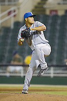 Asheville Tourists relief pitcher Jefri Hernandez (30) in action against the Kannapolis Intimidators at CMC-NorthEast Stadium on July 12, 2014 in Kannapolis, North Carolina.  The Tourists defeated the Intimidators 7-5 in 15 innings.  (Brian Westerholt/Four Seam Images)